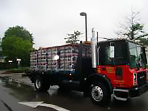 Asphalt emulsion truck to deliver pallets of tack